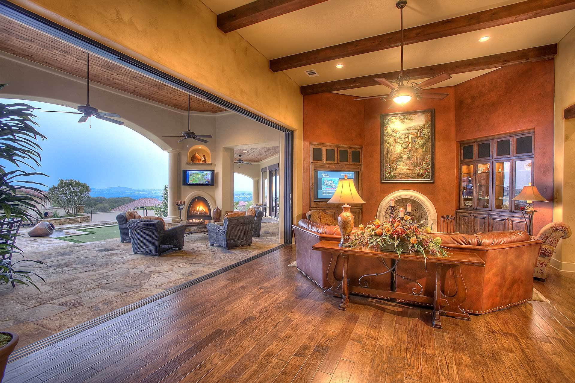Spanish Mediterranean 5123 - Living Room featuring 16' Retractable Glass Wall